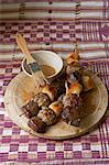 Traditional African cooking. Nigerian meat kebabs made with minced beef, chicken and ostrich cubes Stock Photo - Premium Royalty-Free, Artist: Photocuisine, Code: 682-05977610