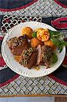 Traditional African cooking. Roast saddle of springbok with spiced fruit chutney served with rice balls Stock Photo - Premium Royalty-Free, Artist: Robert Harding Images, Code: 682-05977619