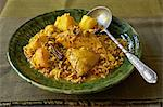 Traditional African cooking. Chicken breyani. Ingredients: chicken pieces, lentils, rice, turmeric, cinnamon, cardamom, potatoes Stock Photo - Premium Royalty-Free, Artist: Aflo Relax, Code: 682-05977629