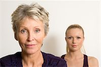 Portrait of mature mother with adult daughter Stock Photo - Premium Royalty-Freenull, Code: 6106-05978592