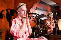 Drag queen sitting at vanity getting ready Stock Photo - Premium Rights-Managednull, Code: 842-05979286