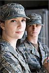 Soldiers in army combat uniform, woman in focus Stock Photo - Premium Rights-Managed, Artist: Kablonk! RM, Code: 842-05979314