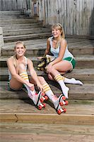 roller skate - Young women putting on rollerskates Stock Photo - Premium Rights-Managednull, Code: 842-05979340