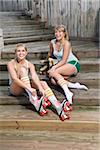 Young women putting on rollerskates Stock Photo - Premium Rights-Managed, Artist: Kablonk! RM, Code: 842-05979340