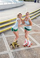 roller skate - Two young woman rollerskating Stock Photo - Premium Rights-Managednull, Code: 842-05979342