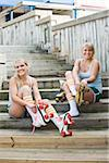 Young women putting on rollerskates Stock Photo - Premium Rights-Managed, Artist: Kablonk! RM, Code: 842-05979346