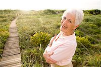 Portrait of smiling senior woman standing outdoors Stock Photo - Premium Rights-Managednull, Code: 842-05979480