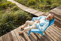 Senior man sitting on chair snoozing in the sun Stock Photo - Premium Rights-Managednull, Code: 842-05979507