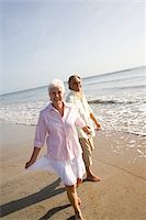 Senior couple strolling on the beach holding hands Stock Photo - Premium Rights-Managednull, Code: 842-05979519