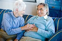 Senior couple sitting on blue striped couch Stock Photo - Premium Rights-Managednull, Code: 842-05979555