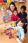 Group of children with teacher in preschool learning shapes Stock Photo - Premium Rights-Managed, Artist: Kablonk! RM, Code: 842-05979654