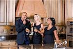 Mid-adult multi-racial friends chatting kitchen drinking wine Stock Photo - Premium Rights-Managed, Artist: Kablonk! RM, Code: 842-05979757