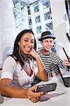 Teenage couple using technology in restaurant booth Stock Photo - Premium Rights-Managed, Artist: Kablonk! RM, Code: 842-05979832