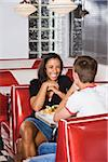 Teenage interracial couple having lunch in a diner Stock Photo - Premium Rights-Managed, Artist: Kablonk! RM, Code: 842-05979833