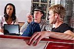Multiracial teens in diner using electronic devices Stock Photo - Premium Rights-Managed, Artist: Kablonk! RM, Code: 842-05979841