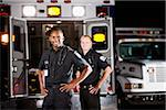 African American paramedic standing next to ambulance with co-worker Stock Photo - Premium Rights-Managed, Artist: Kablonk! RM, Code: 842-05979845