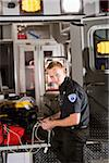 Male paramedic with medical equipment in back of ambulance Stock Photo - Premium Rights-Managed, Artist: Kablonk! RM, Code: 842-05979846