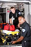 Multiracial paramedics taking stretcher out of ambulance Stock Photo - Premium Rights-Managed, Artist: Kablonk! RM, Code: 842-05979849