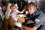 Paramedics caring for elderly patient in ambulance Stock Photo - Premium Rights-Managed, Artist: Kablonk! RM, Code: 842-05979853