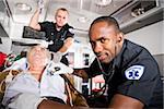 Paramedics caring for elderly patient in ambulance Stock Photo - Premium Rights-Managed, Artist: Kablonk! RM, Code: 842-05979855