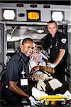 Paramedics caring for elderly patient in ambulance Stock Photo - Premium Rights-Managed, Artist: Kablonk! RM, Code: 842-05979857
