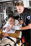 Paramedic caring for elderly patient on stretcher in ambulance Stock Photo - Premium Rights-Managed, Artist: Kablonk! RM, Code: 842-05979873