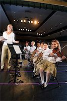 Young students playing musical instruments in school auditorium Stock Photo - Premium Rights-Managednull, Code: 842-05979904