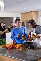 Hispanic family at home in kitchen eating food Stock Photo - Premium Rights-Managednull, Code: 842-05979913