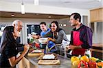 Hispanic mother serving home-cooked meal to family in kitchen Stock Photo - Premium Rights-Managed, Artist: Kablonk! RM, Code: 842-05979919