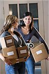 Two young women carrying cardboard boxes down hallway Stock Photo - Premium Rights-Managed, Artist: Kablonk! RM, Code: 842-05979945