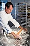 Professional baker rolling dough with pin Stock Photo - Premium Rights-Managed, Artist: Kablonk! RM, Code: 842-05980039