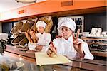 Bakery worker taking customer order Stock Photo - Premium Rights-Managed, Artist: Kablonk! RM, Code: 842-05980057