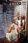 Country girl sitting on bale of hay Stock Photo - Premium Rights-Managed, Artist: Kablonk! RM, Code: 842-05980137