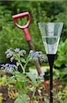 Rain gauge in garden with shovel in background Stock Photo - Premium Royalty-Free, Artist: Blend Images, Code: 698-05980459