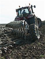 plow - Farmer plowing field Stock Photo - Premium Royalty-Freenull, Code: 698-05980499