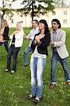 Group of mature peolpe doing trust exercise Stock Photo - Premium Royalty-Free, Artist: Blend Images, Code: 698-05980697