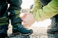 family shoes - Father helping boy tie his shoe lace Stock Photo - Premium Royalty-Freenull, Code: 698-05980792