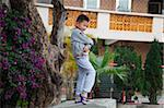 A small boy posing for photo in front of a residential building at Kam Tin, New Territories, Hong Kong Stock Photo - Premium Rights-Managed, Artist: Oriental Touch, Code: 855-05984182