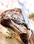 Rib of beef on chopping board