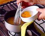 Adding egg yolks to pan for meringue tart Stock Photo - Premium Rights-Managed, Artist: Photocuisine, Code: 825-05987146