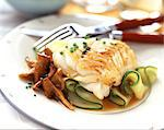 Fillet of cod with Chanterelle mushrooms and courgettes Stock Photo - Premium Rights-Managed, Artist: Photocuisine, Code: 825-05987925