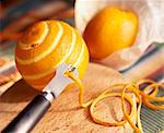 Peeling oranges Stock Photo - Premium Rights-Managed, Artist: Photocuisine, Code: 825-05988285