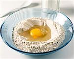 Flour and egg in bowl Stock Photo - Premium Rights-Managed, Artist: Photocuisine, Code: 825-05988790