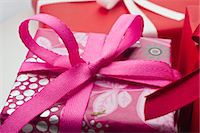 present wrapped close up - Festively wrapped gifts Stock Photo - Premium Royalty-Freenull, Code: 632-05991305