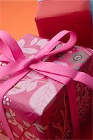 present wrapped close up - Festively wrapped gifts Stock Photo - Premium Royalty-Freenull, Code: 632-05991428