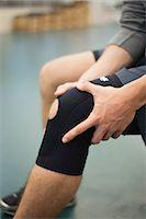 Man wearing knee brace, cropped Stock Photo - Premium Royalty-Freenull, Code: 632-05991585