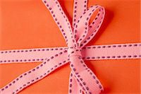 present wrapped close up - Festively wrapped gift Stock Photo - Premium Royalty-Freenull, Code: 632-05991658