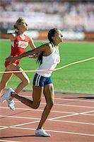 finish line - Female runner crossing finish line Stock Photo - Premium Royalty-Freenull, Code: 632-05991671