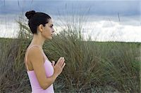 Mature woman in prayer position outdoors, side view Stock Photo - Premium Royalty-Freenull, Code: 632-05991717