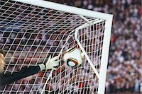 Soccer goalkeeper diving to block ball Stock Photo - Premium Royalty-Freenull, Code: 632-05991799